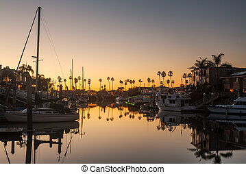 Expensive homes and boats ventura - Sunset over residential...