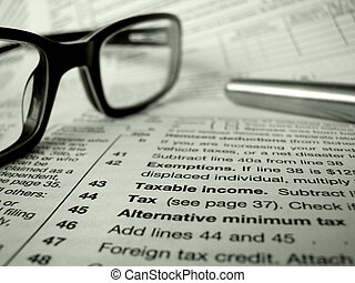 Tax Forms - Financial Image Of Some Tax Forms With Glasses...
