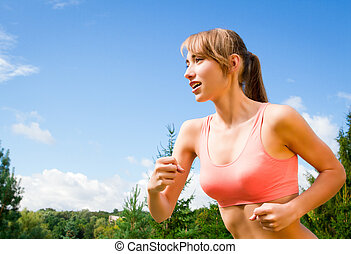 young woman is engaged in outdoor sports, recreation,...