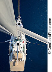 View from the mast on a sailing yac - Top view of a yacht