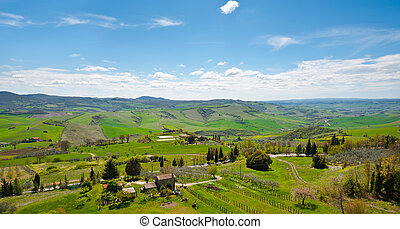Panorama of Farmhouses and Green Sloping Meadows of Tuscany