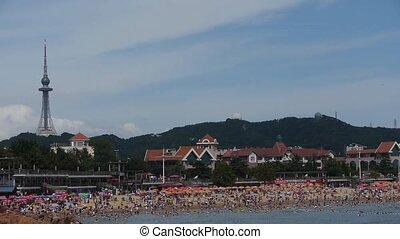 A lot of people at crowded bathing beach.China's Qingdao...