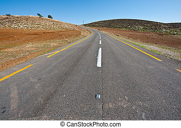 Meandering Road in Sand Hills of Judean Mountain, Israel