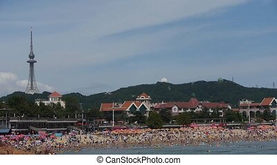 A lot of people at crowded bathing beachChinas Qingdao...