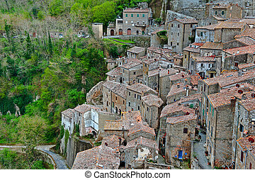 Air View - Birds Eye View on the Roofs of the City of Sorano...