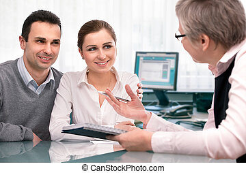 Financial planning consultation - Cheerful young couple at...