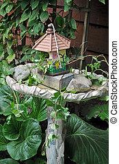 Birdhouse and birdbath - Decorative birdhouse and birdbath...