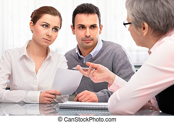 Financial planning consultation - young couple at the...