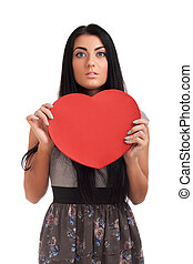 Woman holding Valentines Day heart sign