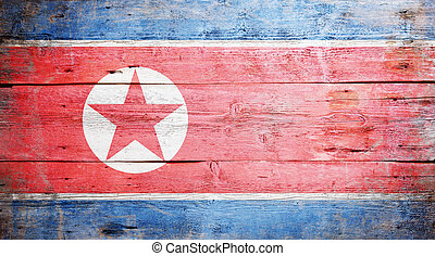Flag of North Korea painted on grungy wood plank background