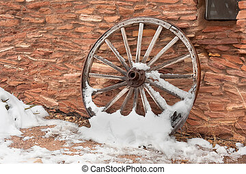 Antique wagon wheel - An old, antique wagon wheel covered in...