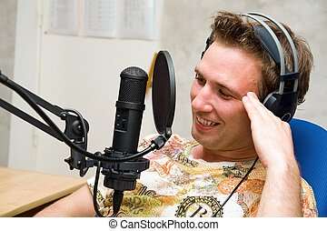 man with microphone - Radio DJ. Young man with microphone...