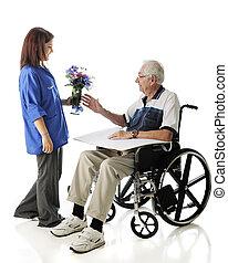 Delivering Flowers - An attractive teen volunteer delivering...