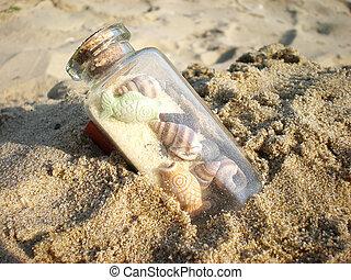 bottle on sand - bottle in sand