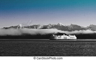 passenger and vehicle ferry - a large ferry crossing the...