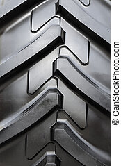 Tractor tire tread background - Detail of a rubber tire on a...