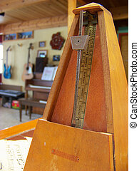 Metronome - Close up of old style metronome with instruments...