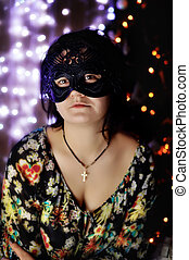The girl in a black mask - Against garlands and a fur-tree...