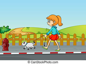 A girl walking with her dog