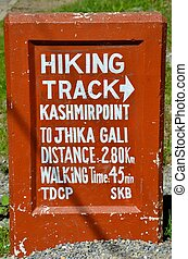 Hiking trails: Murree, Pakistan - Sign showing time and...
