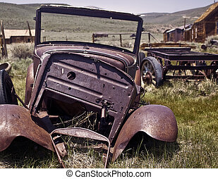 Going Nowhere - A wrecked and broken antique car from Bodie,...