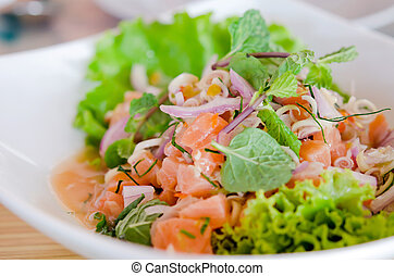 spicy salmon salad , mixed vegetable and herb