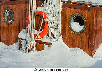 Detail of a sailing ship in winter.