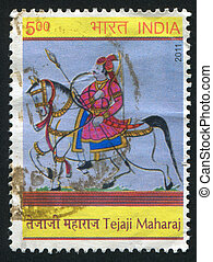 Tejaji Maharaj on a horse - INDIA - CIRCA 2011: stamp...
