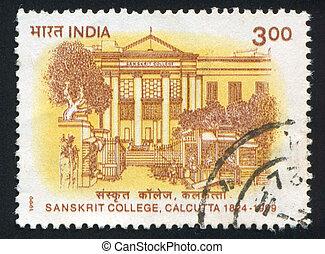 Sanskrit college building - INDIA - CIRCA 1999: stamp...