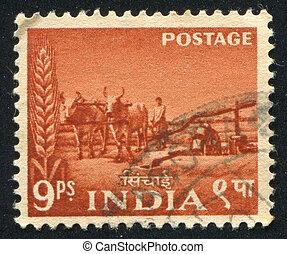 Bullock irrigation pump - INDIA - CIRCA 1955: stamp printed...