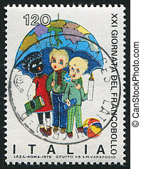 Children of various races under umbrella map - ITALY - CIRCA...