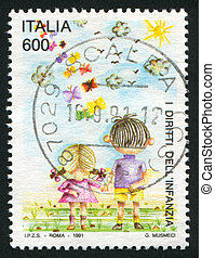 Boy and girl - ITALY - CIRCA 1991: stamp printed by Italy,...