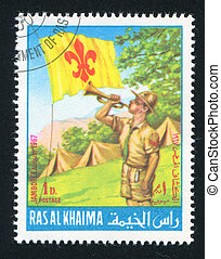 Boy Scout and Camp - RAS AL KHAIMA - CIRCA 1967: stamp...