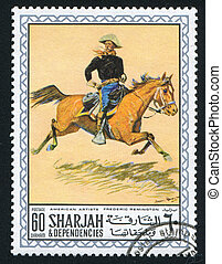 cowboy - SHARJAH AND DEPENDENCIES - CIRCA 1972: stamp...