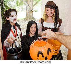 Trick or Treaters at Door - Adorable trick or treaters in...