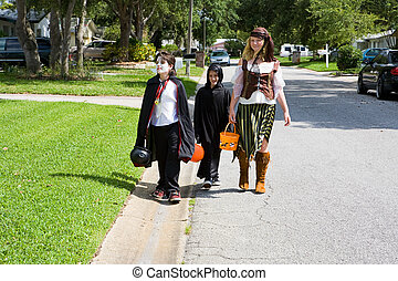 Trick or Treating in Neighborhood - Kids in halloween...