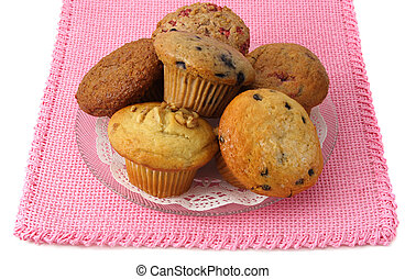 plate of muffins, pink tablecloth