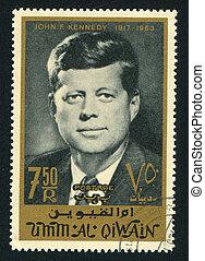 John Kennedy - UMM AL-QUWAIN - CIRCA 1972: stamp printed by...