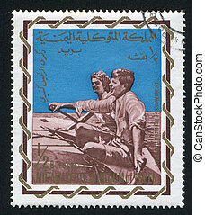 John Kennedy and Wife - YEMEN - CIRCA 1968: stamp printed by...