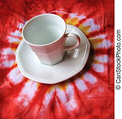 tye die tea cup - white teacup against tye die background