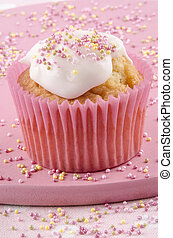 cupcake with icing and colored sprinkles