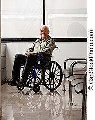 Senior Man On Wheelchair - Portrait of senior man sitting on...