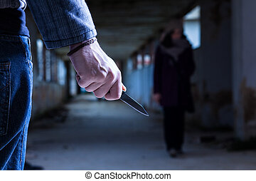 Criminal with Knife Waiting for a Woman