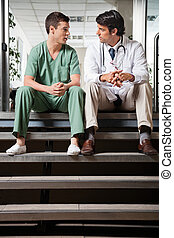 Medical Colleagues Having Discussion - Multiethnic medical...