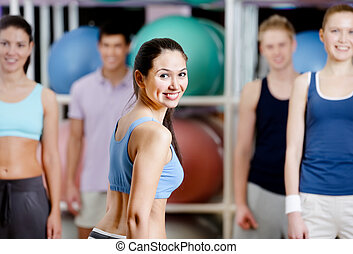 Group of active people at the gym