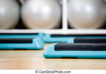 Step boards and gymnastic balls in sports class