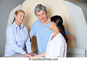Technicians With Mature Female Patient - Multiethnic...