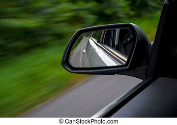 rear view mirror of driving car