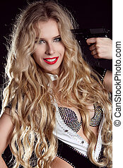 Woman with long blond curly hair at gunpoint