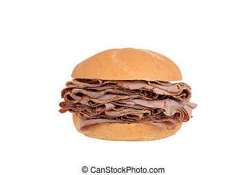 Large roast beef on a bun sandwich - isolated Large roast...